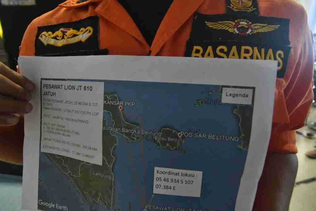 An official holds a map of ongoing search efforts to locate the wreckage of Lion Air flight JT 610, at Pangkal Pinang airport in Bangka Belitung province on October 29, 2018. - A brand new Indonesian Lion Air plane carrying 189 passengers and crew crashed into the sea on October 29, officials said, moments after it had asked to be allowed to return to Jakarta. (Photo by RONI BAYU / AFP) (Photo credit should read RONI BAYU/AFP/Getty Images)