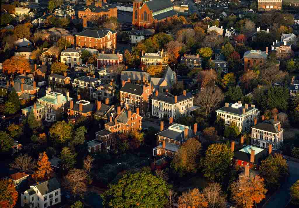 SALEM, MA – OCTOBER 17, 1978: Aerials of Chestnut Street and the Samuel McIntire Historic District of Federal mansions during peak autumn foliage in Salem, Massachusetts on October 17, 1978. The residential neighborhood is named to honor local architect Samuel McIntire, who designed many Federal style houses in the early 19th Century. Critics have called Chestnut Street the prettiest street in America. (Photo by Nathan Benn/Corbis via Getty Images)