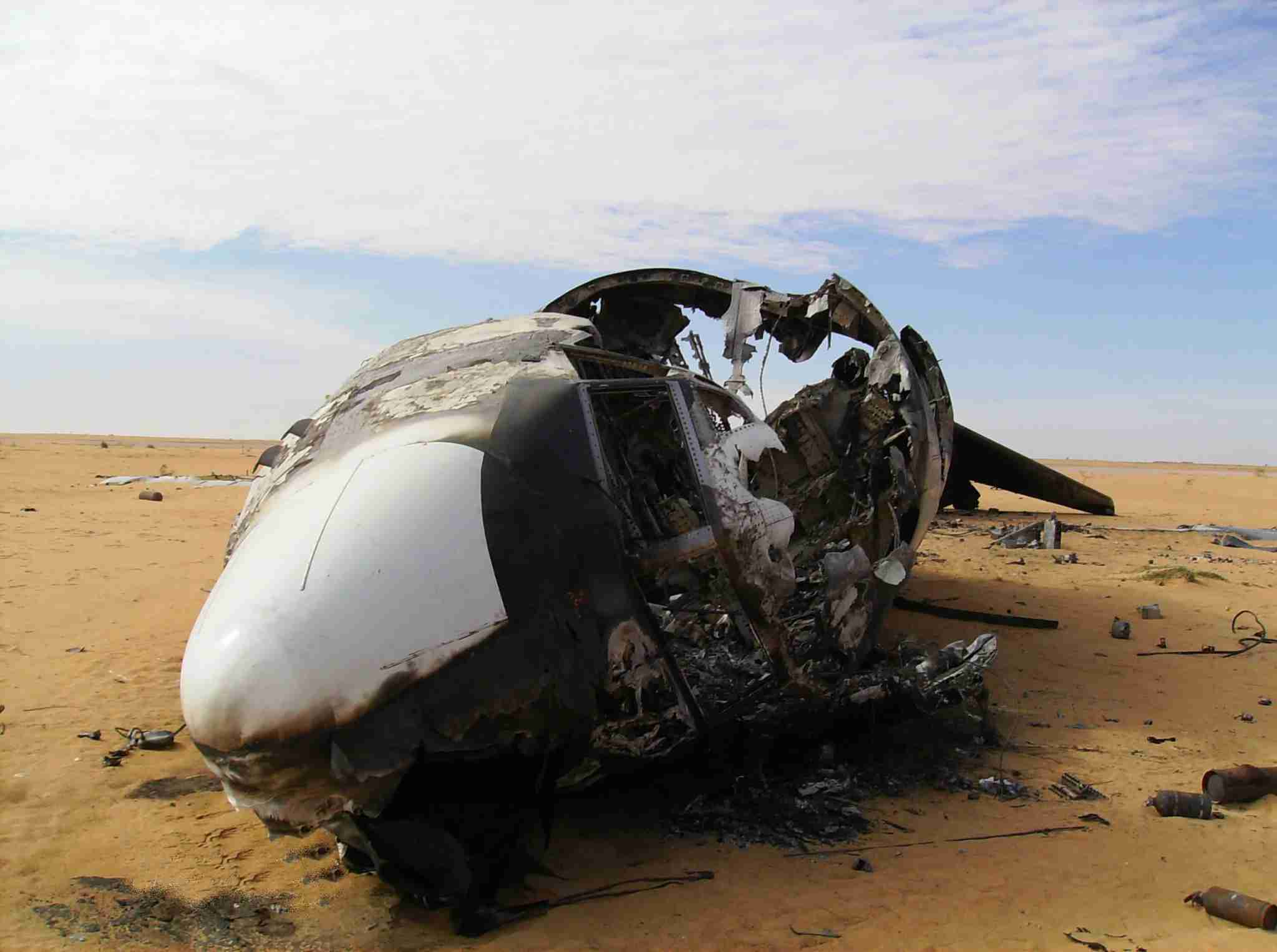 The wreck of a burnt-out Boeing 727 lies in the desert some 200 kilometres (125 miles) north of Gao in the northeast of the impoverished west African country on the southern edge of the Sahara on December 10, 2009. UN authorities said the plane transported cocaine from Venezuela to the west African country. According to the UN Office on Drugs and Crime, the Boeing 727 landed on a makeshift airstrip and unloaded a cargo of illegal drugs before crashing as it tried to take off. AFP PHOTO SERGE DANIEL (Photo credit should read SERGE DANIEL/AFP/Getty Images)