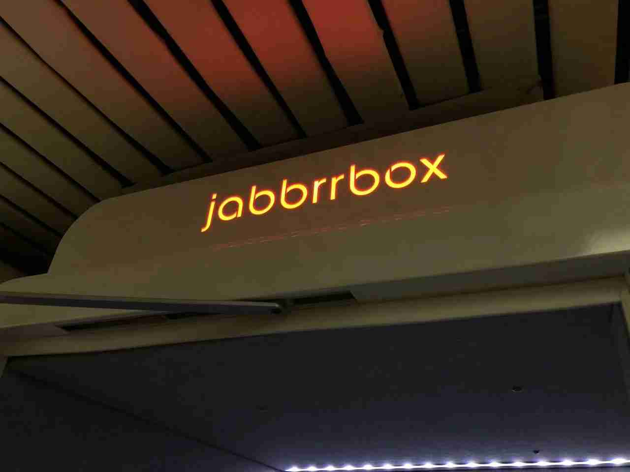 The Jabbrrbox Logo in Red Indicating The Pod Is In Use