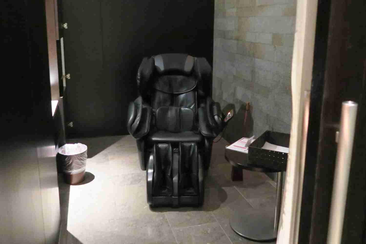 A massage chair in a room previously used for massages.