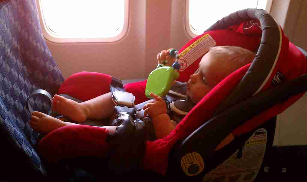 Westin in his car seat on the plane