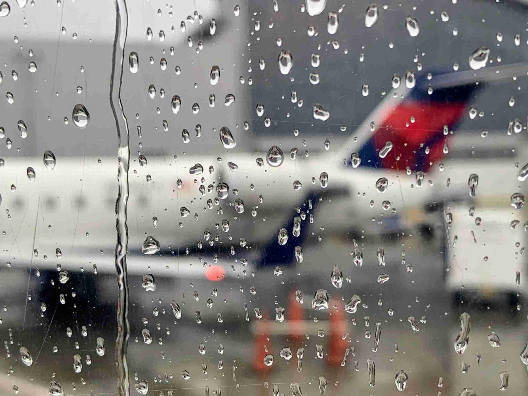 Delta Flight Delay Weather Rain Window