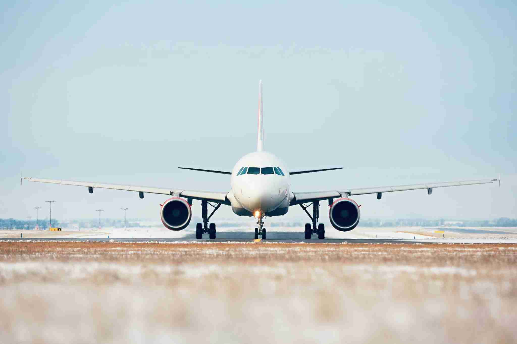 An airplane on an airport runway. (Credit: Jaromir Chalabala/EyeEm via Getty Images)