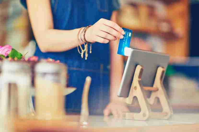 Each time you use your credit card, the merchant hands over 2 - 4 percent of the transaction in fees. Image courtesy of Neustockimages via Getty Images.