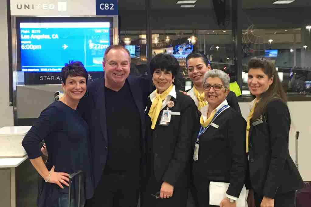 Tom Stuker poses with United employees ahead of his flight to LAX. Photo courtesy United Airlines.