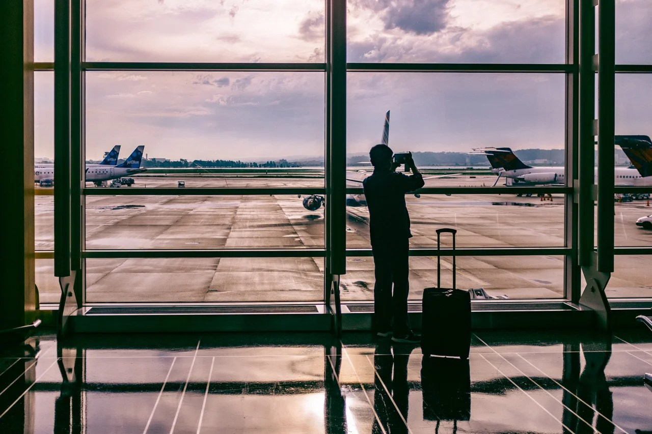 The taller you are, the longer the handle should be on your rolling suitcase. (Photo by Ashim D'Silva via Unsplash)