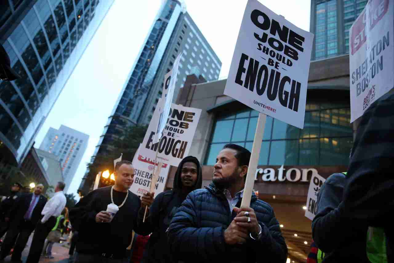 BOSTON, MA - OCTOBER 3: Workers and supporters picket outside the Sheraton Boston by Marriott in Boston on Oct. 3, 2018. Hotel workers walked off the job at seven Marriott hotels in Boston Wednesday morning, launching the first hotel strike in the citys history following months of fruitless contract negotiations. The job action involves more than 1,500 Marriott International employees, from housekeepers to bartenders to bellmen at the Aloft Boston Seaport District, Element Boston Seaport District, Ritz-Carlton Boston, Sheraton Boston, W Hotel Boston, Westin Boston Waterfront, and Westin Copley Place. (Photo by Craig F. Walker/The Boston Globe via Getty Images)
