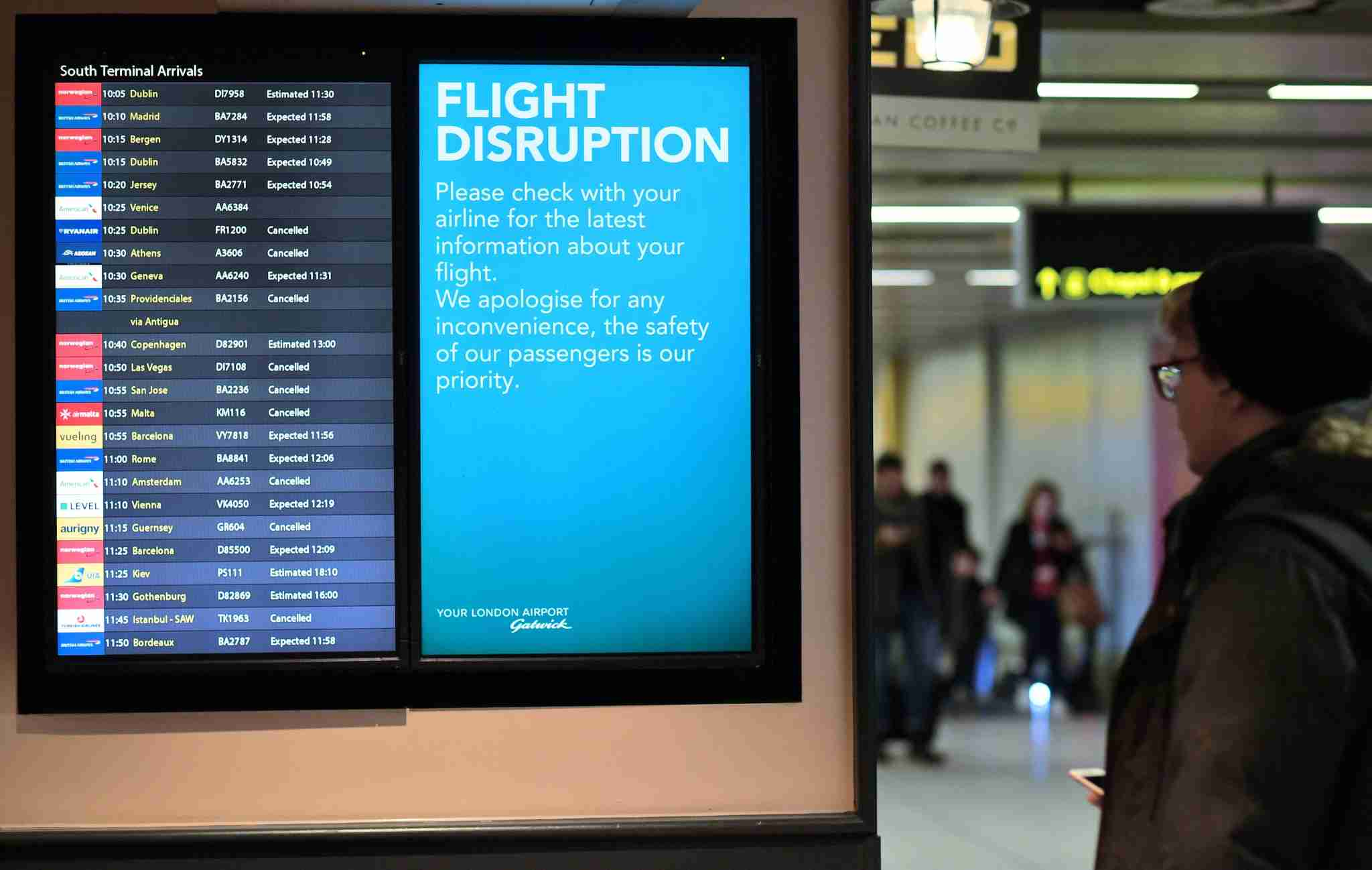 An information board displays flight information follwing disruption, in the South Terminal building at London Gatwick Airport, south of London, on December 21, 2018, as flights started to resume following the closing of the airfield due to a drones flying. - British police were Friday considering shooting down the drone that has grounded flights and caused chaos at London