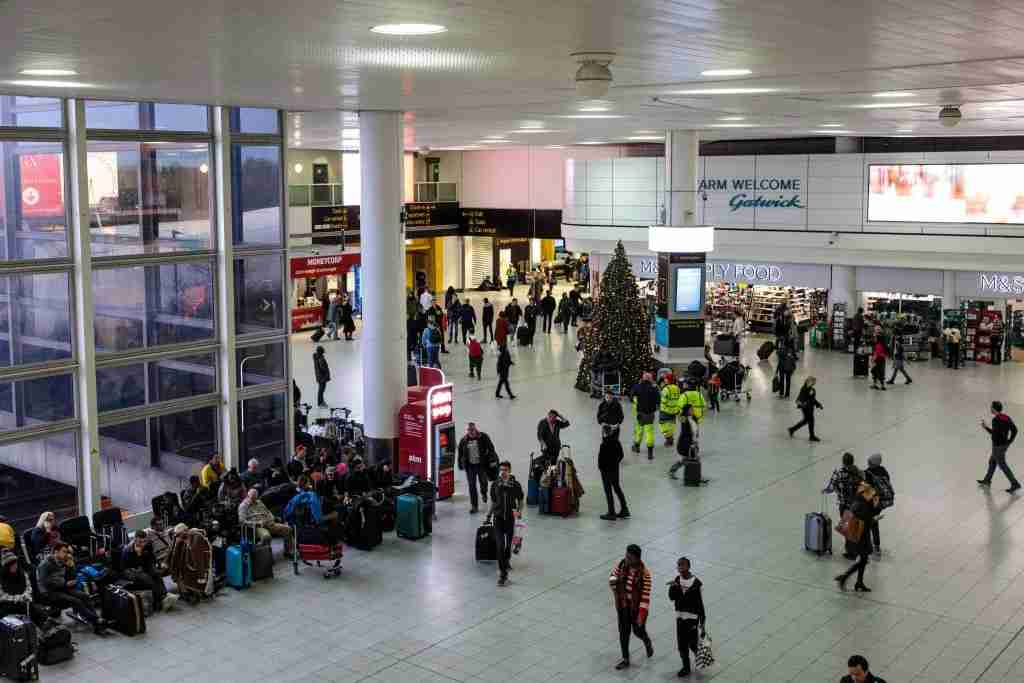 "LONDON, ENGLAND - DECEMBER 21: Passengers wait in the South Terminal building at London Gatwick Airport after flights resumed today on December 21, 2018 in London, England. Authorities at Gatwick have reopened the runway after drones were spotted over the airport on the night of December 19. The shutdown sparked a succession of delays and diversions in the run up to the Christmas getaway, in what authorities have called a ""deliberate act"" to disrupt the airport. Police continue their search for the drone operators responsible. (Photo by Jack Taylor/Getty Images)"