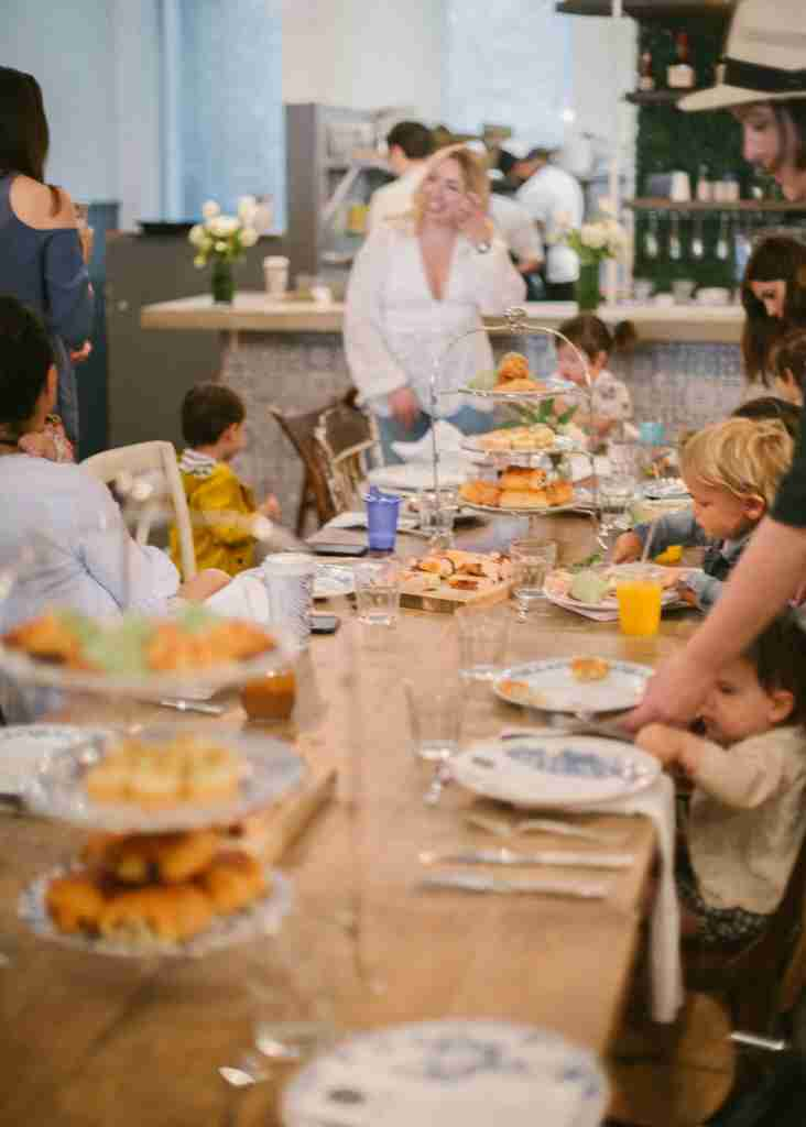 Children and parents enjoy a tea time brunch at Maman in Tribeca, New York City.