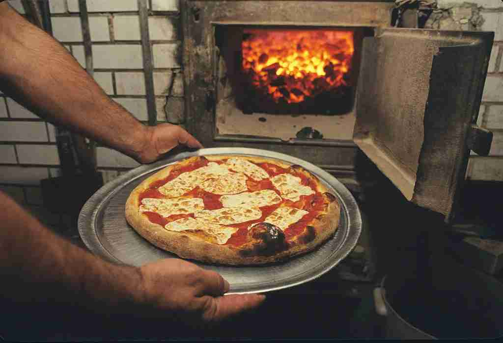 Pizza cooked in a brick oven at Lombardi