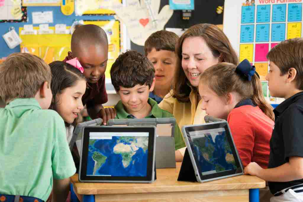 kids with maps in a classroom