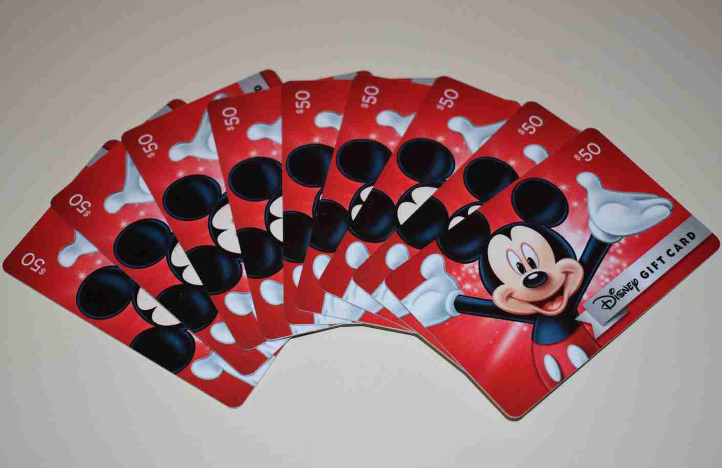 The stack of Disney gift cards I used to upgrade to an annual pass. Image by Ross Binkley / The Points Guy.