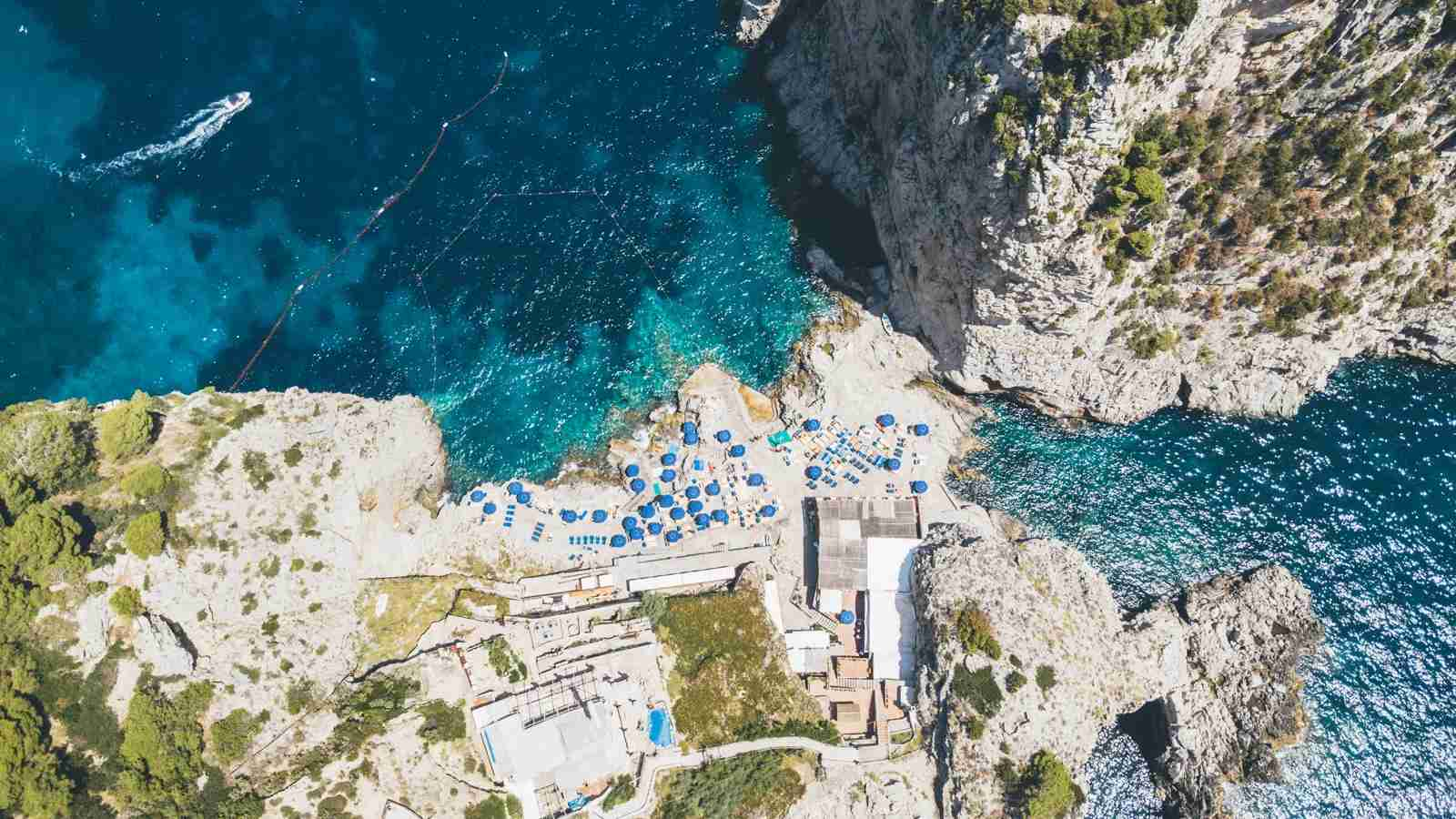 A Faraglioni rock beach in Capri, Italy. (Photo via Shutterstock)