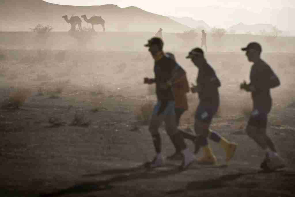 Runners at the Marathon des Sables in the Sahara Desert. (Photo by JEAN-PHILIPPE KSIAZEK/AFP/Getty Images)