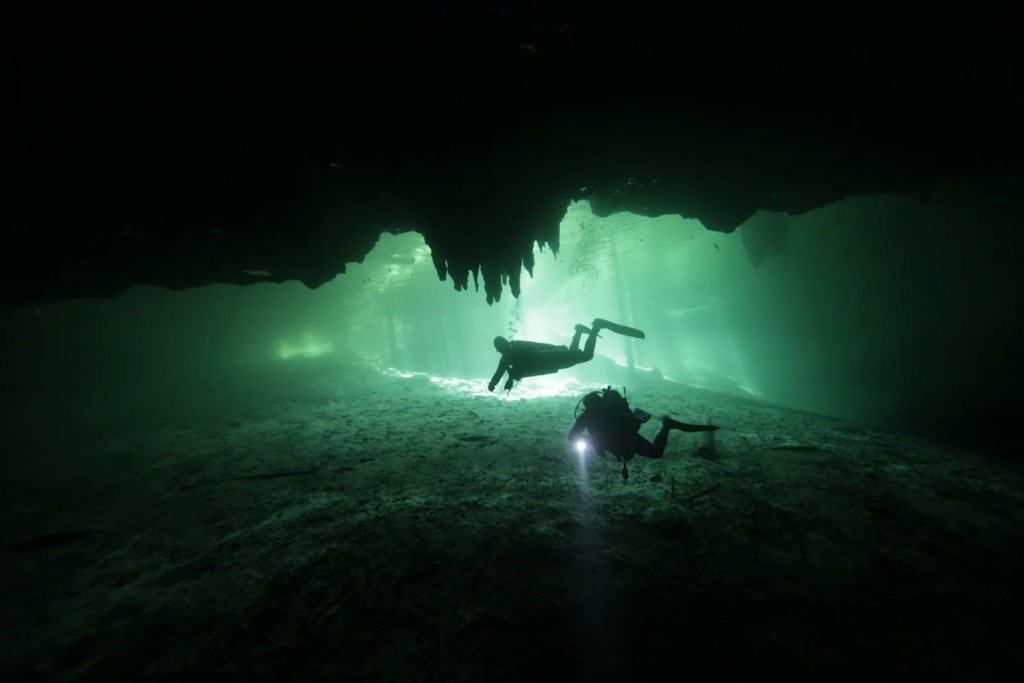 Cave diving through Riviera Maya in Mexico. (Photo via Shutterstock)