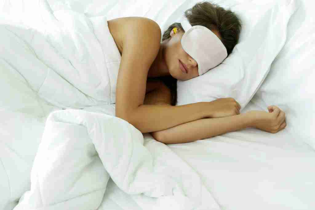 Sleep with earplugs and an eye mask on to get a good night