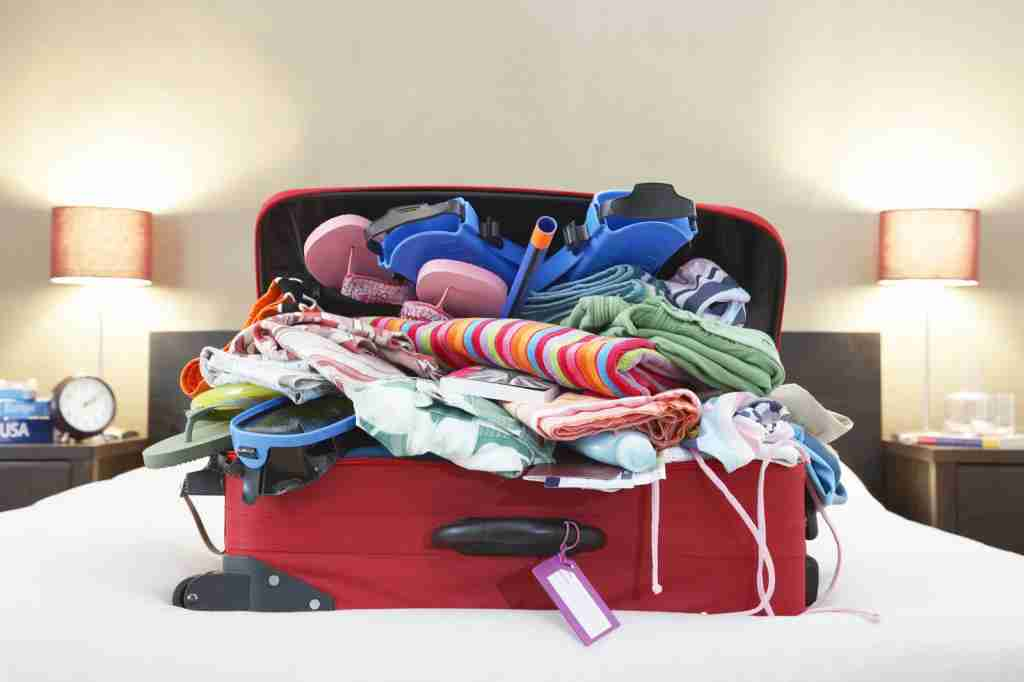 That bag you overstuffed with items might make for the perfect overhead weight while doing some squats in your room. (Photo via Shutterstock)
