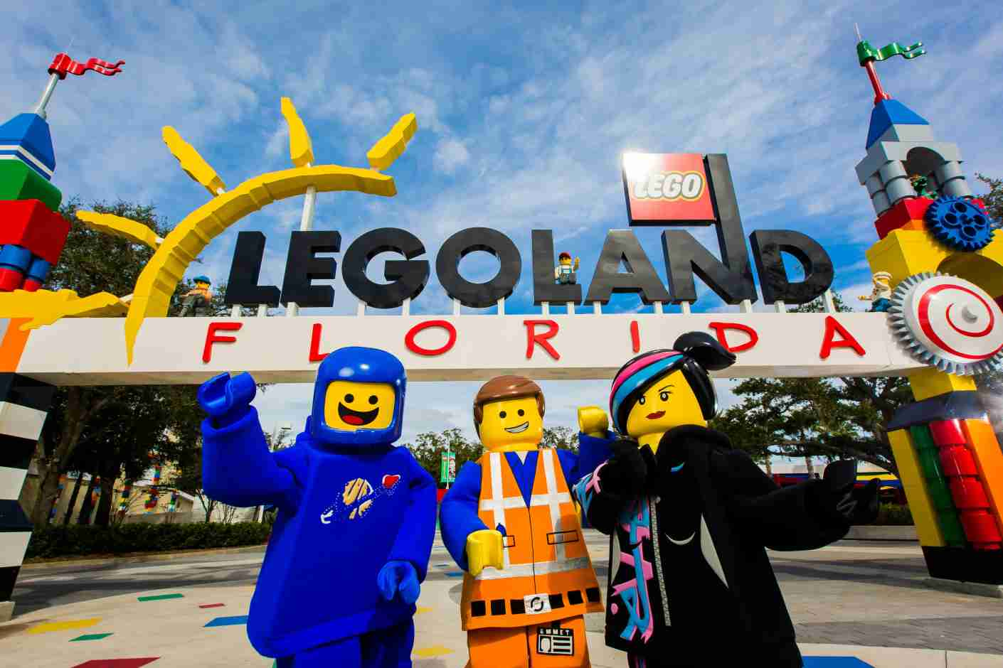 """WINTER HAVEN, FL -- January 26, 2016 -- Emmet, Wyldstyle, and Benny return to print their handprints in cement in preparation for """"The LEGO® Movie™ 4D A New Adventure"""" premiering Friday at LEGOLAND® Florida Resort in Winter Haven, Florida. (PHOTO / Chip Litherland Photography for LEGOLAND Florida Resort)"""