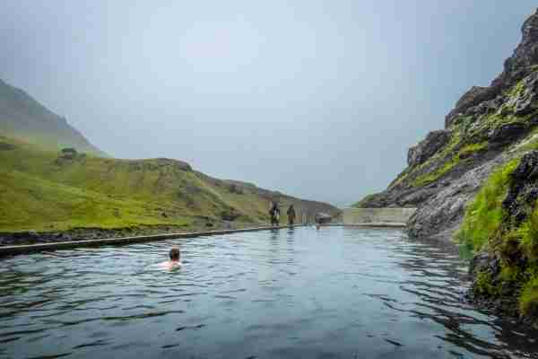A man made thermal pool in Southern Iceland uses diverted water from an underground hot spring and reaches temperatures close to 85 degrees F. (Photo by John Fredricks/NurPhoto via Getty Images)