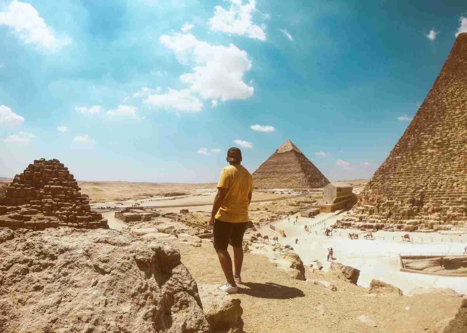 Check out the pyramids when visiting Cairo, Eygpt. (Photo by Omar Elsharawy/Unsplash)