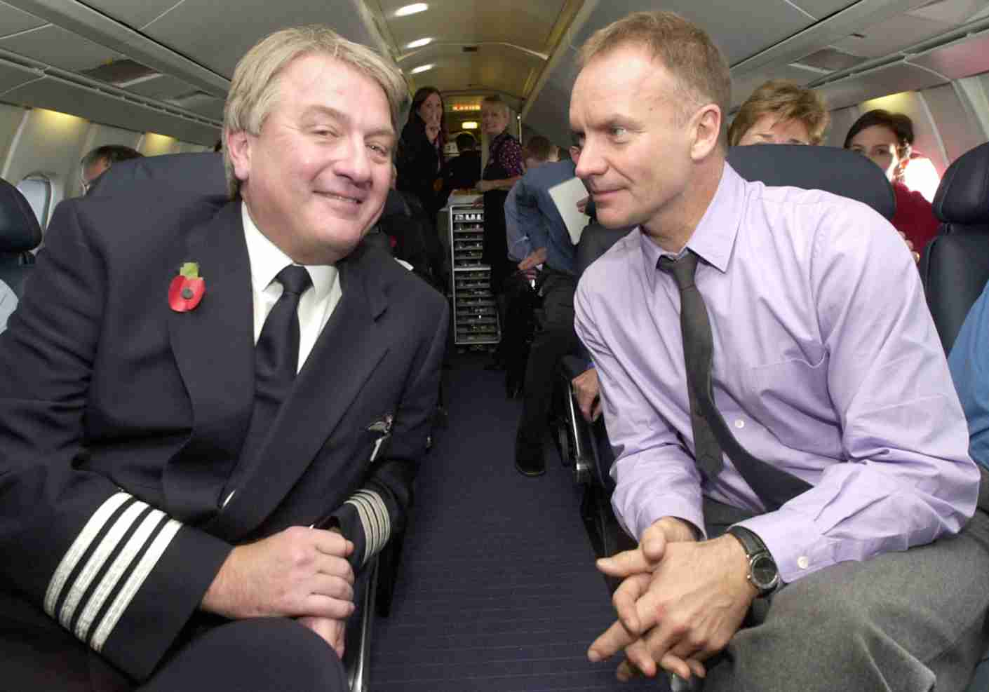 Captain Mike Bannister talks to rock star Sting on a British Airways Concorde making its first commercial flight from London to New York after the aircraft were grounded following last July
