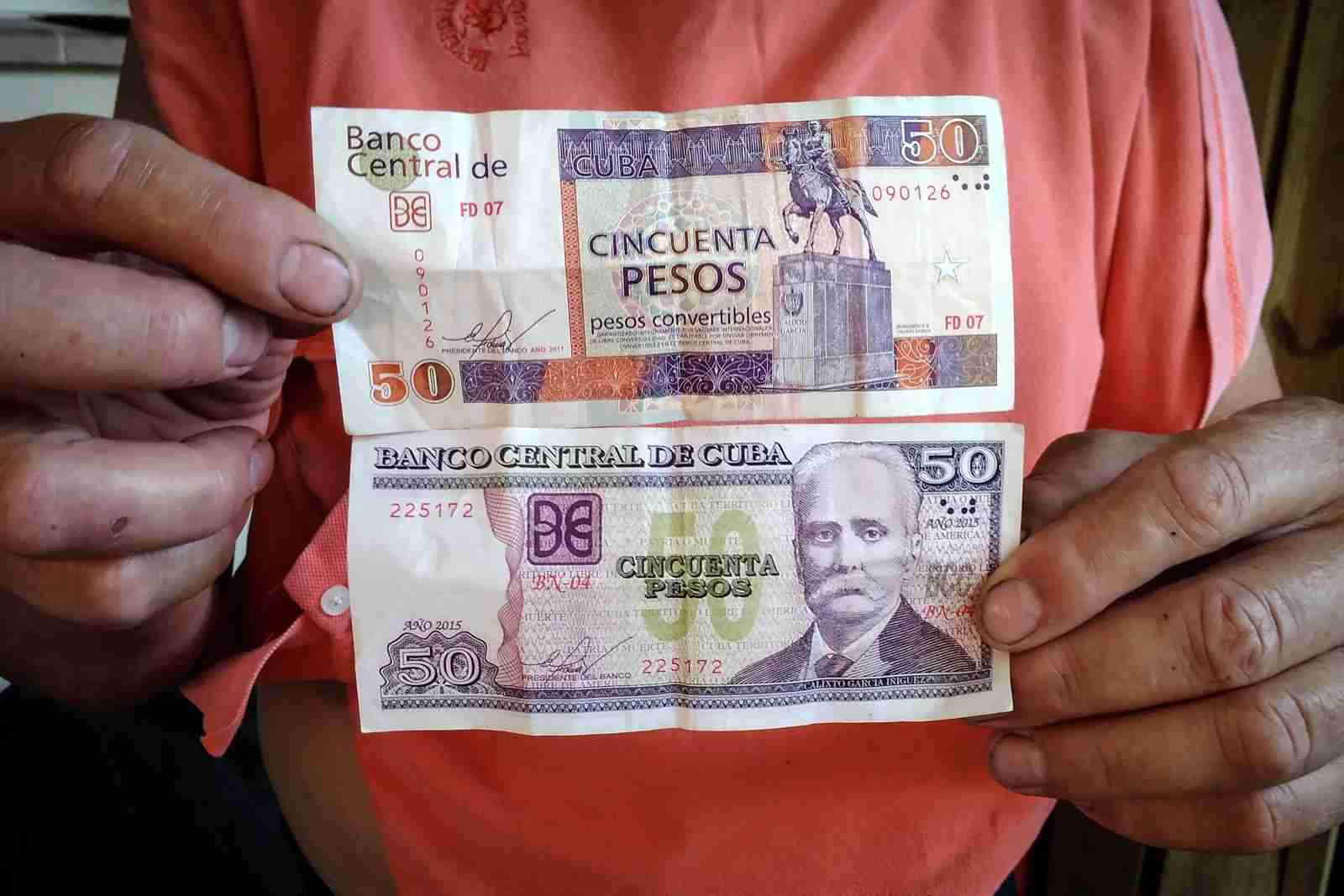 50 CUP (Cuban pesos; bottom) and 50 CUC (Cuban convertible pesos; top). (Photo by ADALBERTO ROQUE/AFP/Getty Images)