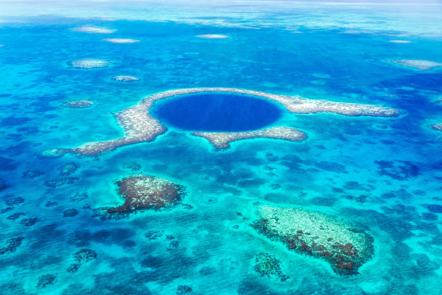 Aerial photo of the Blue Hole, Lighthouse reef, Belize. (Photo via Getty Images)