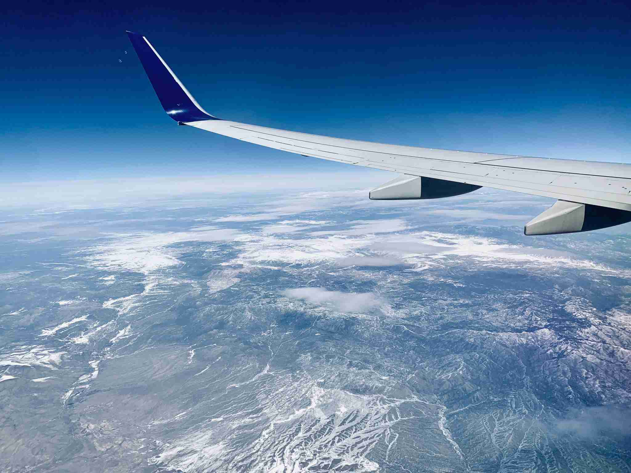 delta-wing-airplane-view-mountains-window-landscape