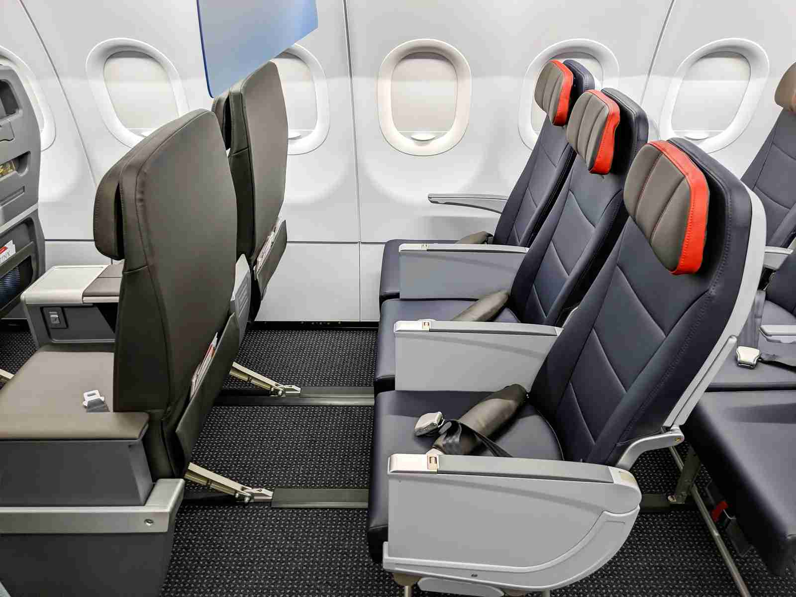 The front row of economy on the American Airline A321neo measures 40 inches of pitch -- and you can store a bag under the first class seat in front of you. (Photo by JT Genter/The Points Guy)