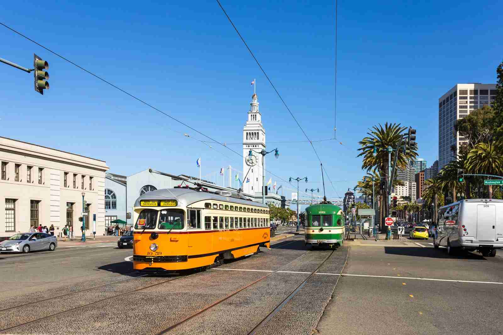 The tramway on the Embarcadero along San Francisco waterfront in California, USA. The clock tower in the background in the historic ferry terminal building. (Photo by Didier Marti / Getty Images)
