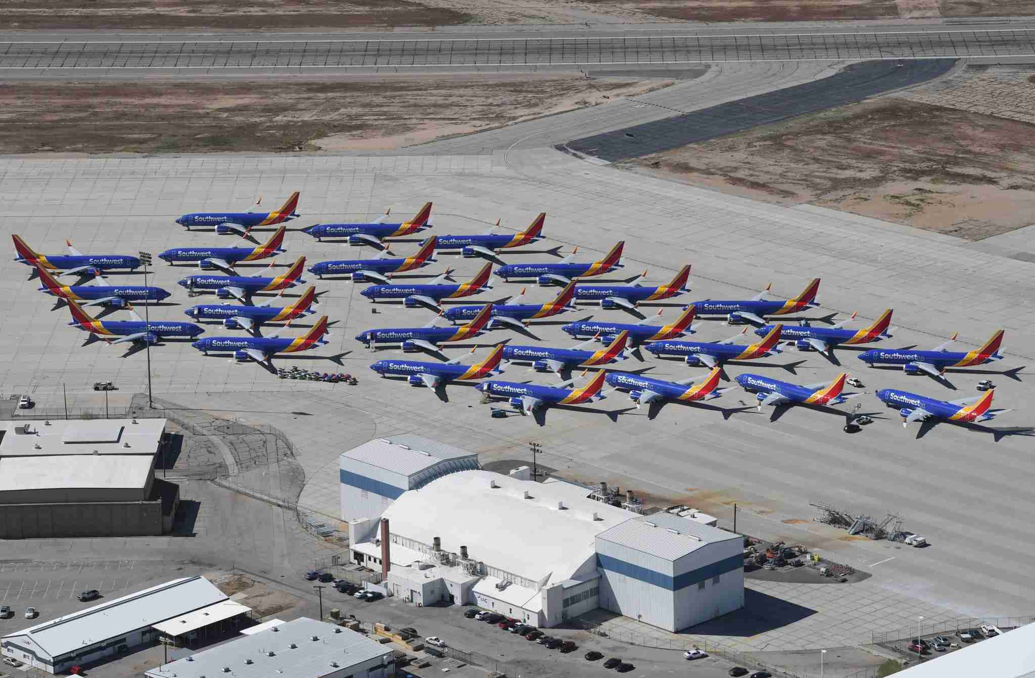 Southwest Airlines Boeing 737 MAX aircraft are parked on the tarmac after being grounded, at the Southern California Logistics Airport in Victorville, California on March 28, 2019. - After two fatal crashes in five months, Boeing is trying hard -- very hard -- to present itself as unfazed by the crisis that surrounds the company. The company