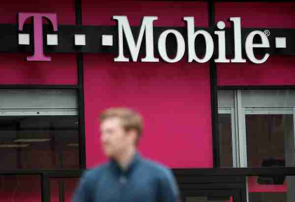 SAN FRANCISCO, CA - APRIL 24:  A pedestrian walks by a T-Mobile store on April 24, 2017 in San Francisco, California. T-Mobile will report first quarter earnings today after the closing bell.  (Photo by Justin Sullivan/Getty Images)