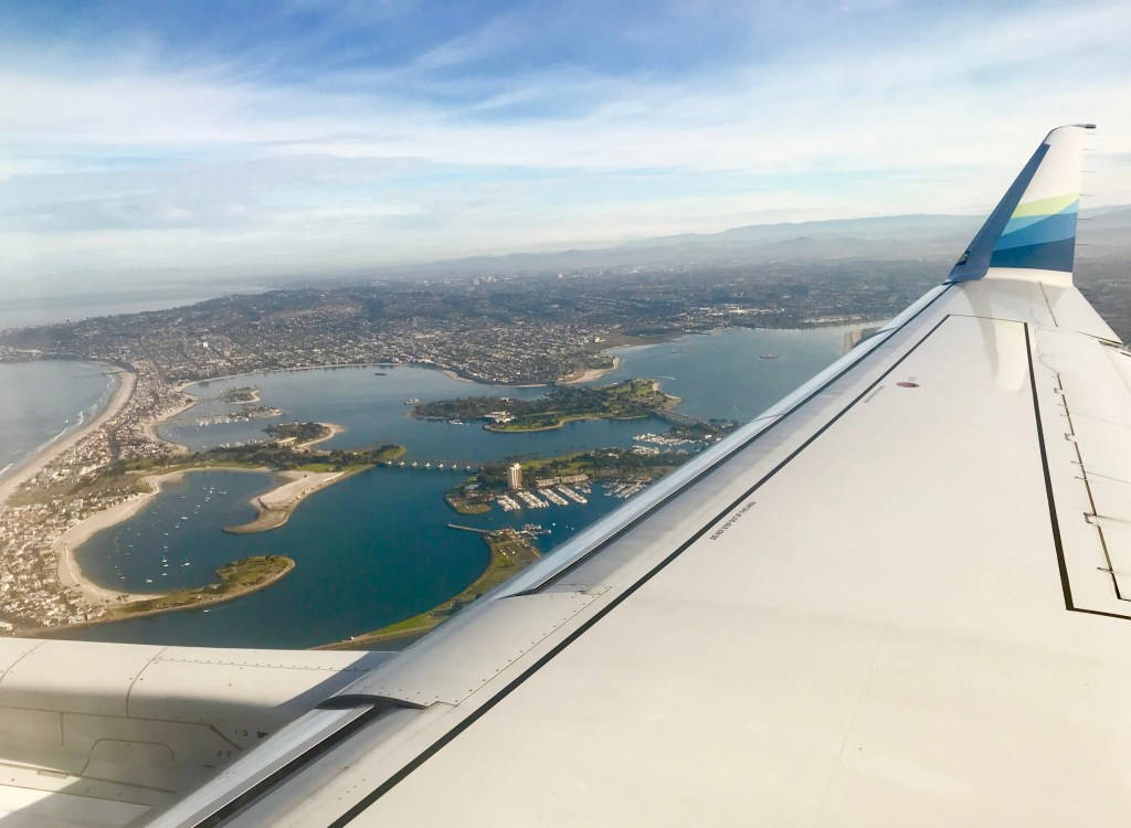Alaska Airlines wing and view of San Diego Mission Bay