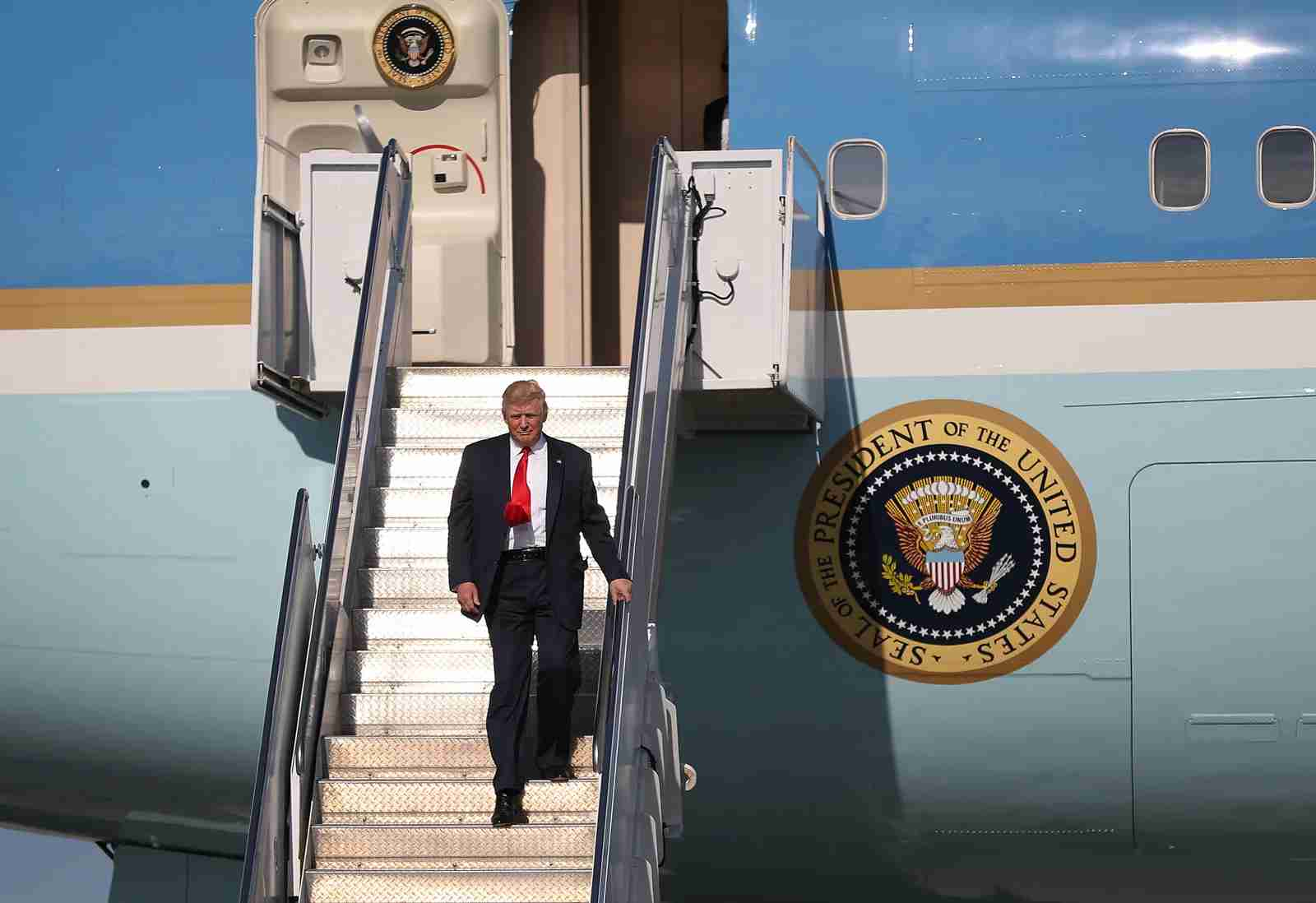 President Donald Trump arrives on Air Force One at the Palm Beach International Airport to spend the weekend at Mar-a-Lago resort in February 2017. (Photo by Joe Raedle/Getty Images)