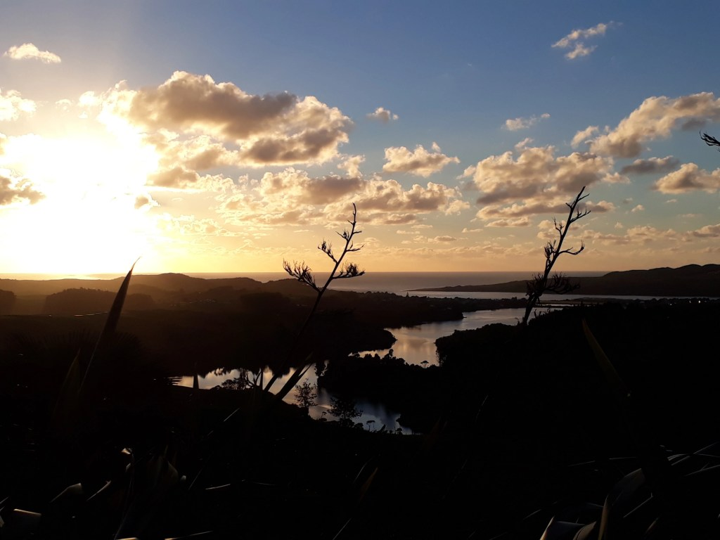 Sunset from a simple campground near Raglan, New Zealand. Photo: Elen Turner