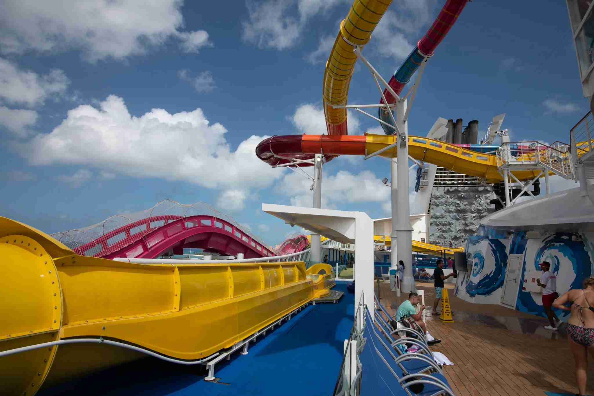 The Blaster water slide and Riptide, a mat racer slide, intertwine along the top deck of Royal Caribbean