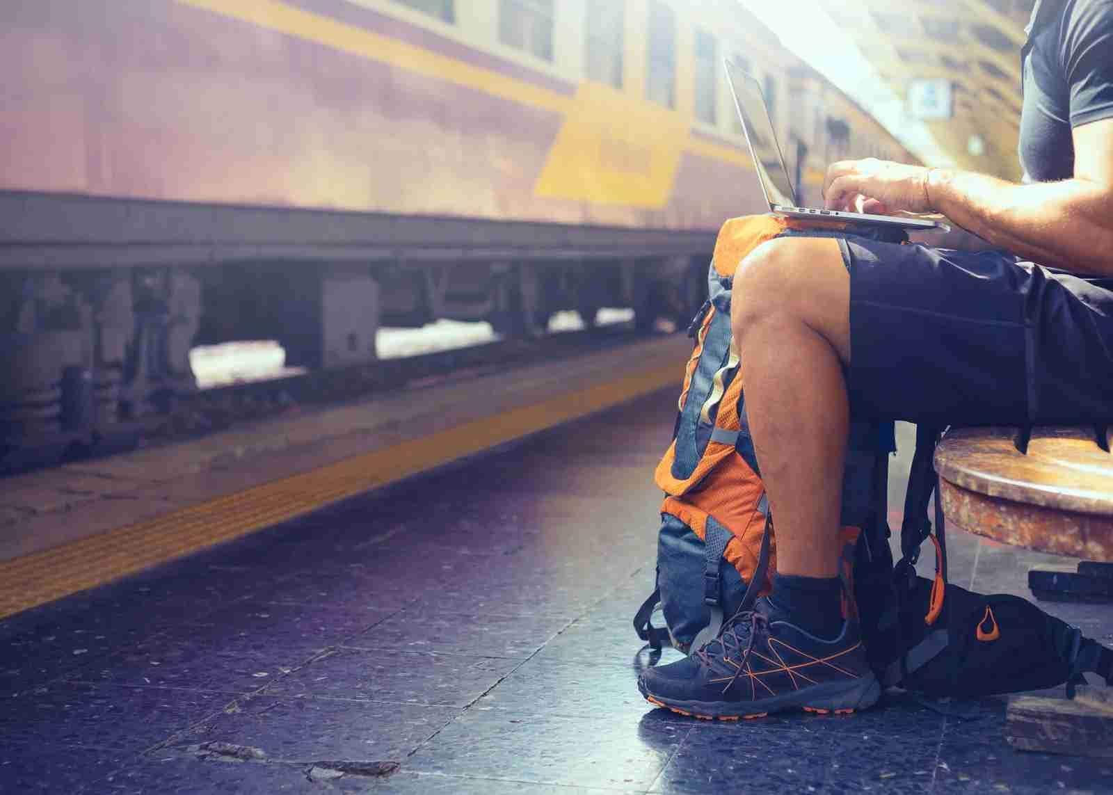 Digital nomad backpacker computer train station