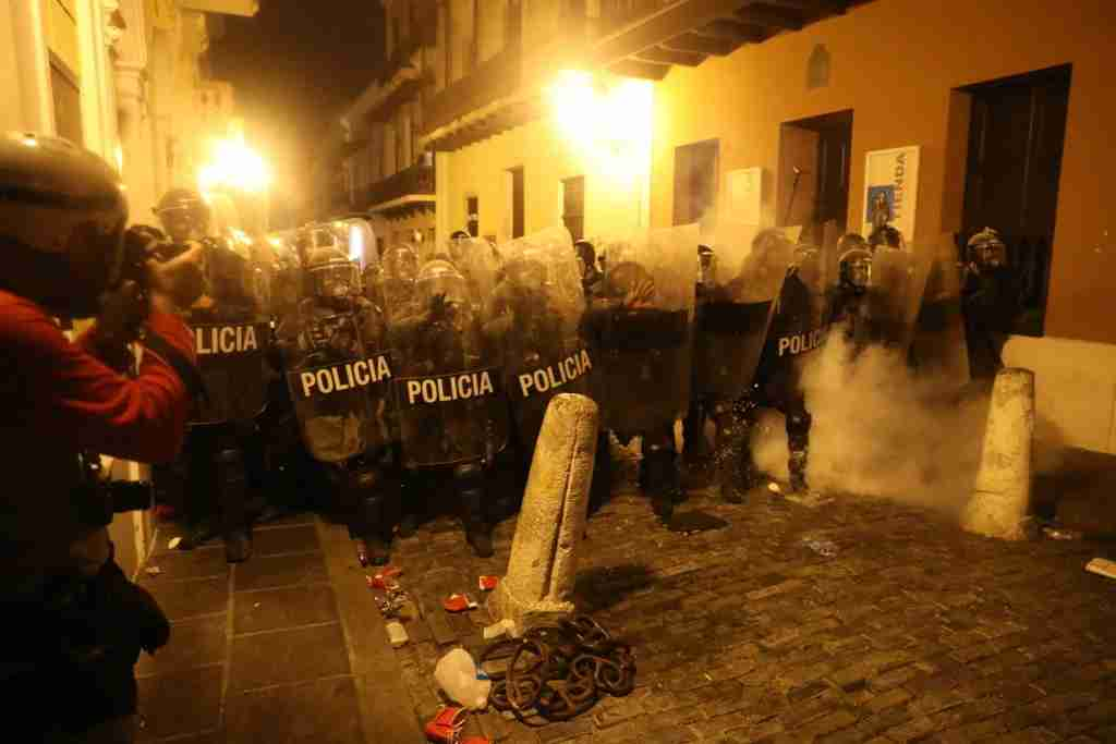 SAN JUAN, PUERTO RICO - JULY 17: Demonstrators and police face off during a protest against Ricardo Rossello, the governor of Puerto Rico on July 17, 2019 in Old San Juan, Puerto Rico. Police used tear gas and reportedly fired rubber bullets late Wednesday evening during the protest. There have been calls for the governor to step down after it was revealed that he and top aides were part of a private chat group that contained misogynistic and homophobic messages. (Photo by Joe Raedle/Getty Images)