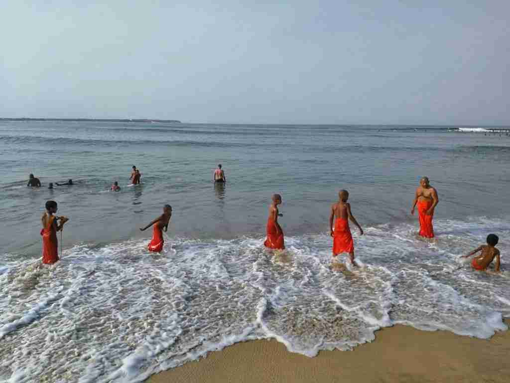 Monks frolic in the Sri Lanka sea. Photo by Lori Zaino.