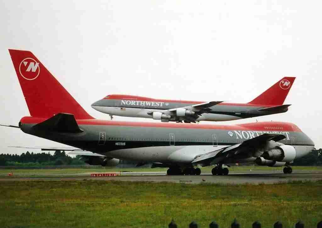 Northwest 747s at Tokyo Narita airport. (Photo by JetPix/Wikimedia Commons)
