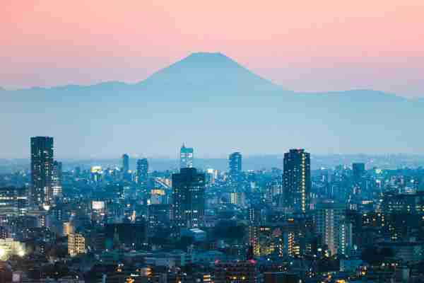 Mt. Fuji and Tokyo downtown at sunset. Tokyo, Japan (Photo by  Matteo Colombo/Getty Images)