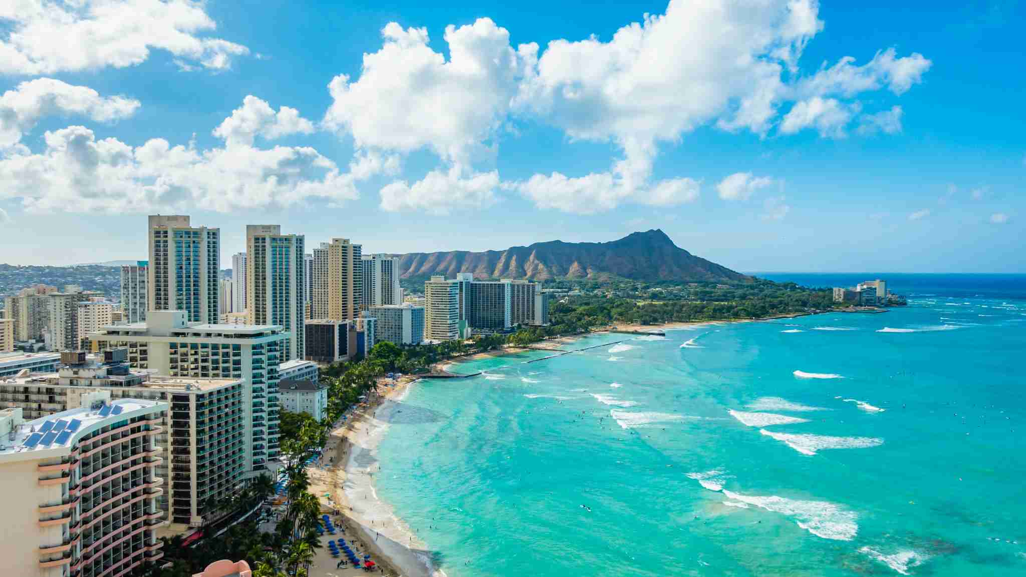Waikiki Beach and Diamond Head Crater including the hotels and buildings in Waikiki, Honolulu, Oahu island, Hawaii. Waikiki Beach in the center of Honolulu has the largest number of visitors in Hawaii (Photo by okimo/Getty Images)