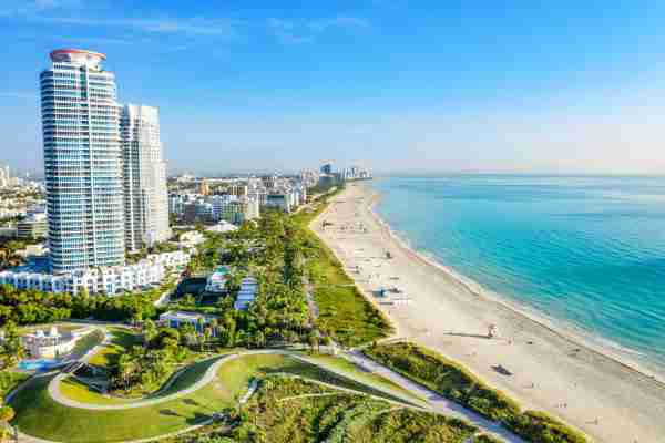 Panoramic high view of South Beach at Miami South Pointe Park with high skyscrapers and a blue sunny summer sky, Florida, USA. Brickell district skyscrapers close to downtown Miami in the southern spot of South Beach. (Photo by Pola Damonte/Getty Images)