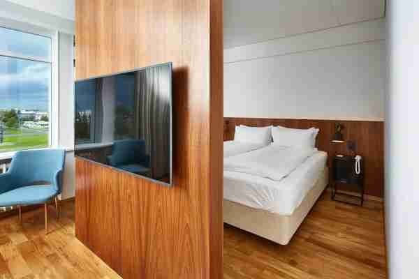 Theres a nice privacy wall between the bed and living area. Photo courtesy of Booking.com)