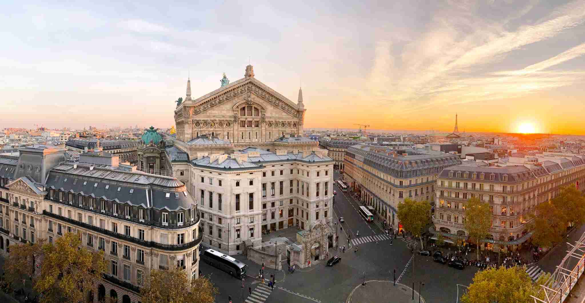 Panoramic view of the Paris skyline at sunset. (Photo by Alexander Spatari/Getty Images.)