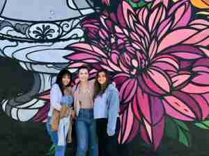 These girls loved posing in front of various murals on Melrose Avenue. (Photo courtesy of 2DadsWithBaggage)
