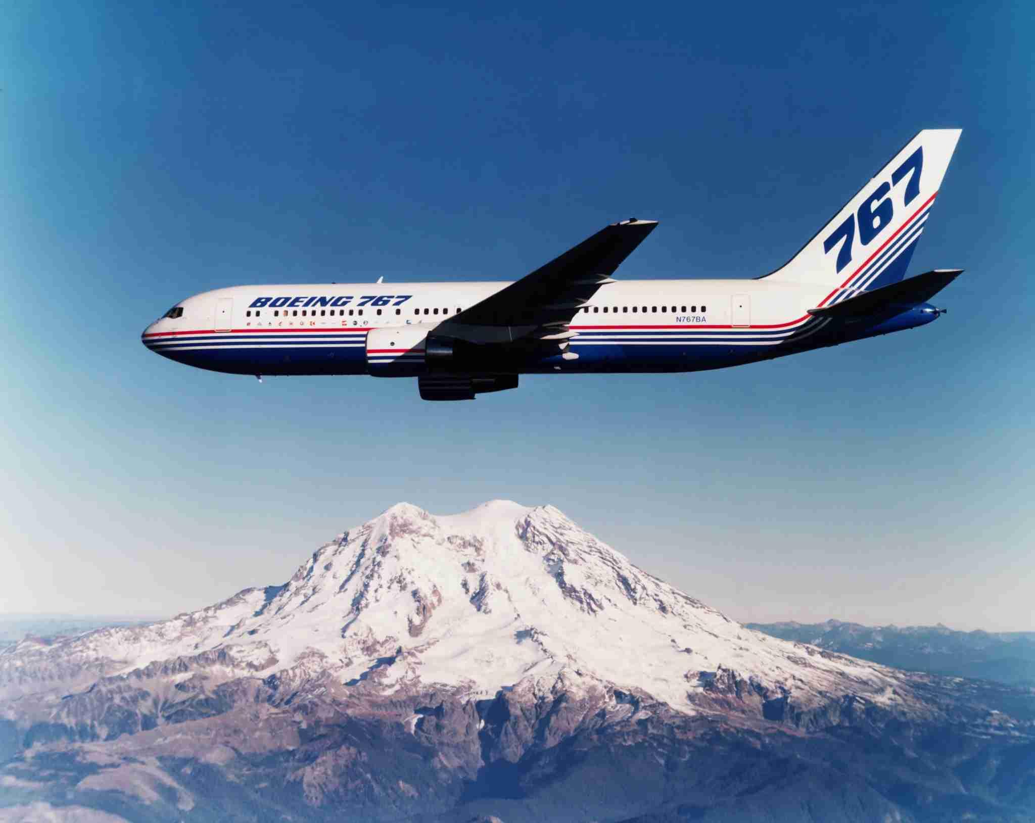 A Boeing 767-200B prototype jet flies near Mount Rainier. Washington, 1980s. (Photo by © Museum of Flight/CORBIS/Corbis via Getty Images)