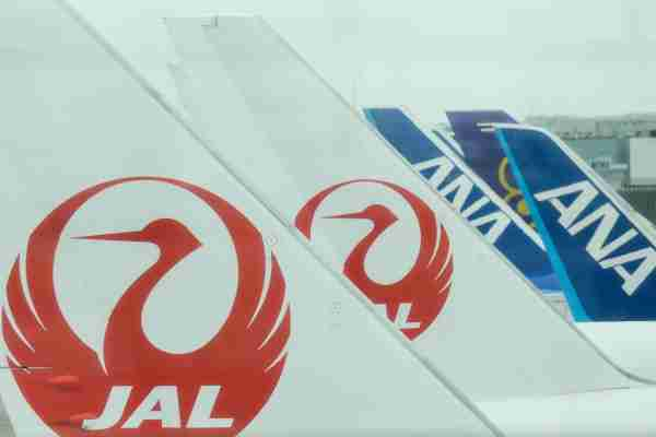 JAL (Japan Airlines) and ANA (All Nippon Airways) planes at Tokyo International Airport, known as Haneda Airport. on Sunday 30 October 2016, in Haneda, Japan. (Photo by Artur Widak/NurPhoto via Getty Images)